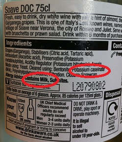 Wine label showing 'contains milk' warning