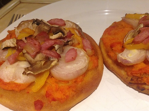 Venice Bakery small pizza bases with pepper sauce, onions, bacon and mushrooms