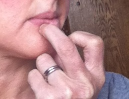 Digging your finger nail into cold sore tingle