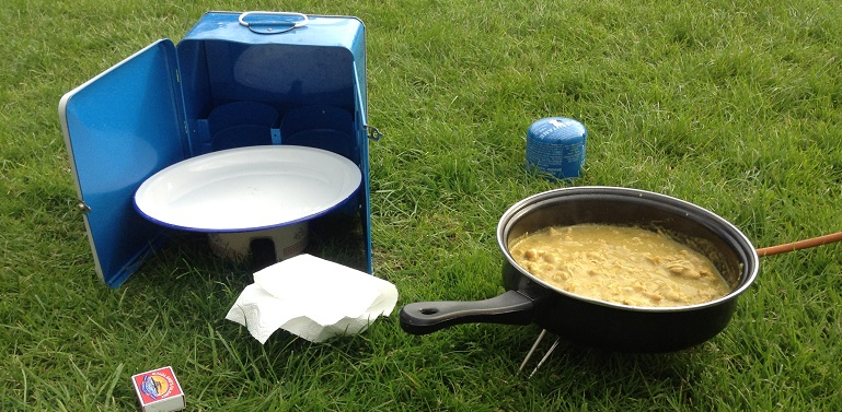 Cooking ilumi on a camp stove