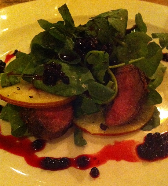 Seared 'Studham' pigeon breast with apple and watercress and elderberry dressing