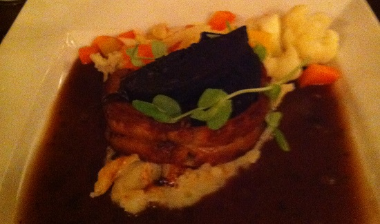 Duck with black pudding on a bed of herb mashed potato