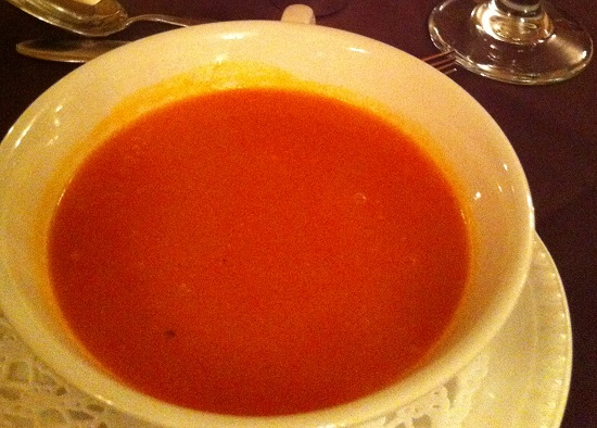 Red pepper soup with a gluten and wheat free bread roll